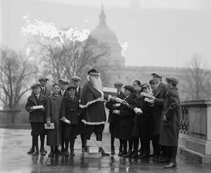 Robert Stanfield (R-OR) as Santa Claus with Senate Pages, 1924
