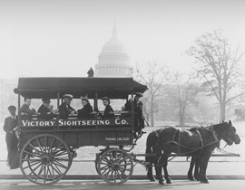 Photo of horse-drawn tour bus in front of Capitol Building.