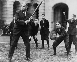 A senator plays baseball with young Senate pages.