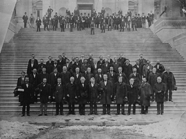 Photograph of senators standing on the Capitol steps.