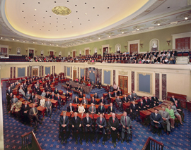 Photograph of all one hundred senators at their desks in the Senate Chamber.