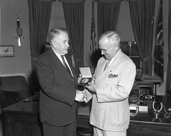 Picture of Alben Barkley receiving Congressional Gold Medal from Harry Truman