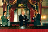 Senator Byrd is welcomed to the Old Senate Chamber by Senators Tom Daschle (left) and Trent Lott (right).