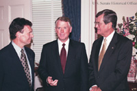 Vice President Quayle chats with Senators Tom Daschle (left) and Trent Lott (right) in the Office of the Majority Leader.