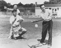 Photograph of three senators playing baseball.