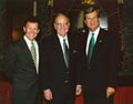 Image: Senators Tom Daschle and Trent Lott welcome George Mitchell.