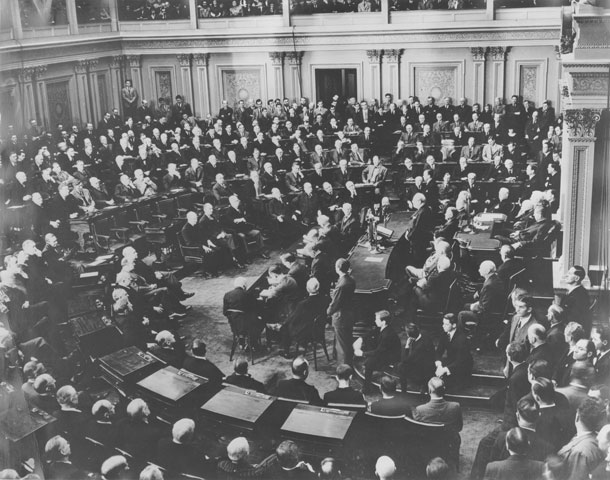 Photo of Winston Churchill speaking to legislators in crowded Senate Chamber.