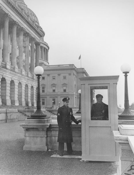 Photo of two policemen on guard in front of Capitol Building