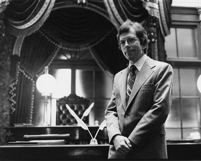 Senate Historian Richard Baker in the Old Senate Chamber, 1976